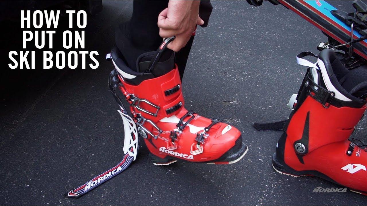 putting on ski boots